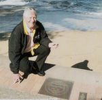 Barclay Wade  with Plaque Pathway of Olympians