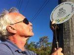 Volunteer Keith Burn affixing a memorial plaque